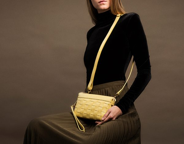 Yellow Mellow Mini Clutch - It's a functional little bag. You can take all your necessities with you on your way out.